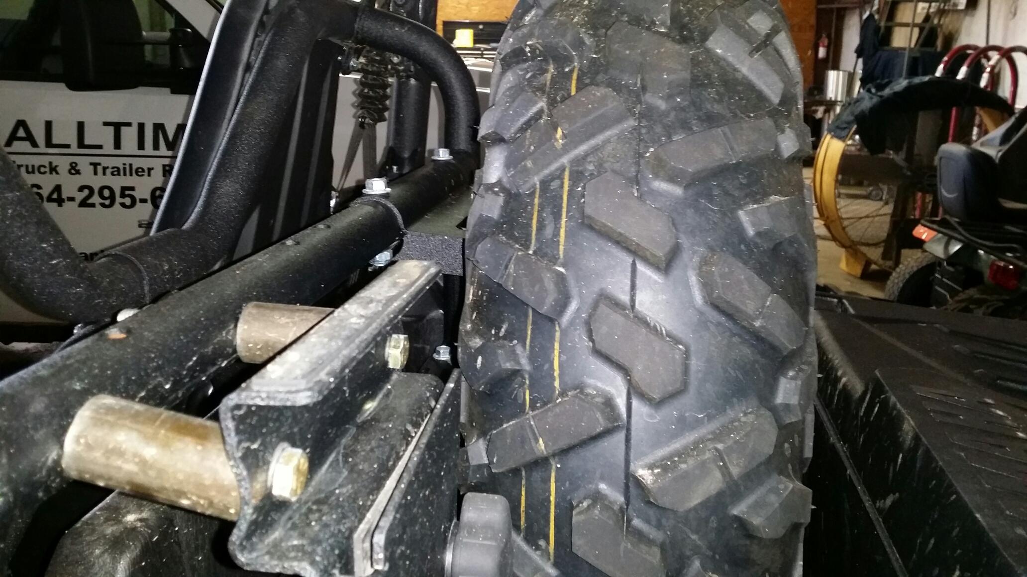 Name:  Driverside View Tire Holder.jpeg Views: 1153 Size:  1.12 MB
